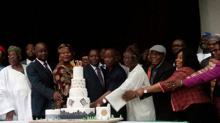 Cutting the 70th anniversary cake