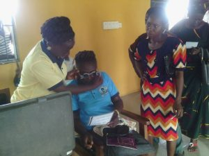 Dr. Bukky attending to a patient