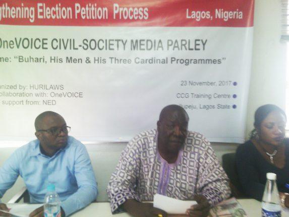 Adeleye (m) addressing the press