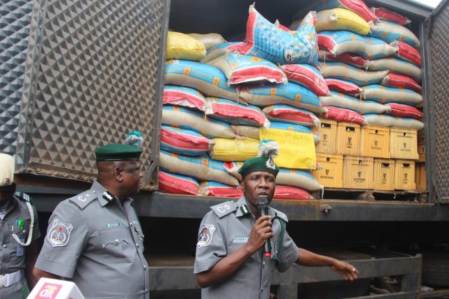 ‎L-R: Deputy Comptroller, Nigeria Customs, Mr. Dauda Ashigye and Comptroller, Mohammed U. Garba, during the press briefing on. Seized items by the Nigeria Customs including 6,206 bag of foreign parboiled rice in Lagos.