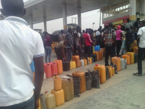 Long line for fuel at a filling station at Ogba, Lagos