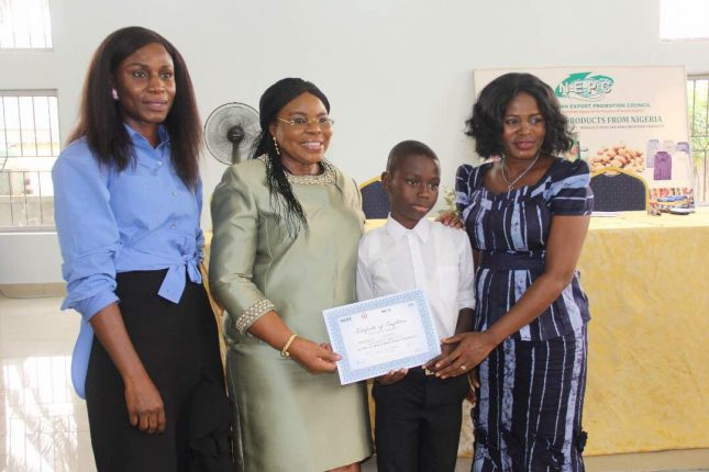 HCDC Consultant, Mrs. Omoyemi Akerele, a Director at NECA, Mrs. Samuel, Master Okafor and Head Admin & HR, NEPC, Lagos, Mrs. Bolanle Emmanuel, presenting the certificate of training to Okafor at the graduation ceremony in Lagos...recently