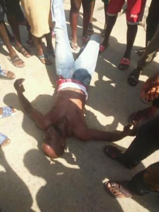 Photo Caption: Injured protesters being rescued on Tuesday by sympathisers as police clash with protesters at the Niger Delta University Amasoma, southern Jaw local government area of Bayelsa.