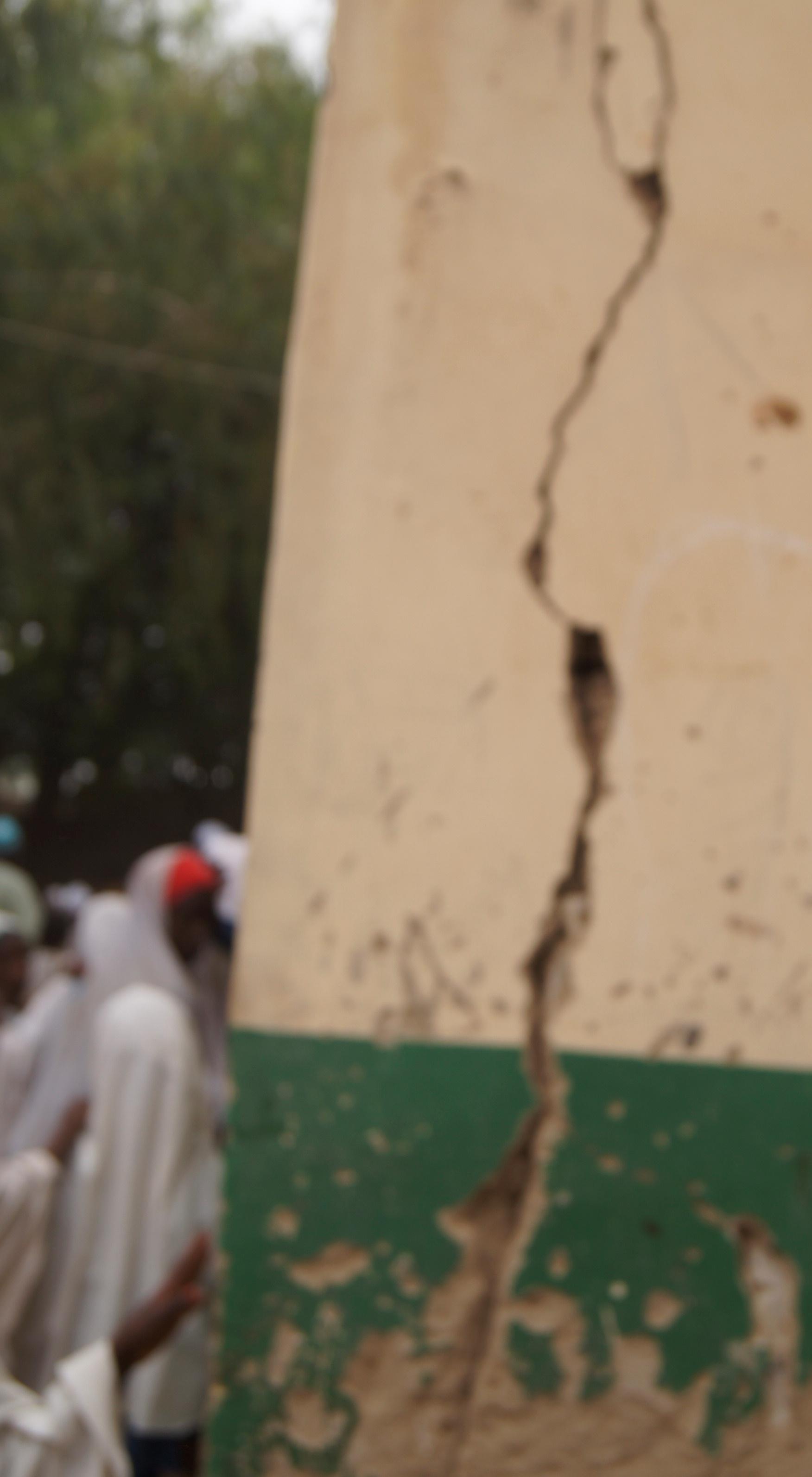 Massive cracks on classroom wall