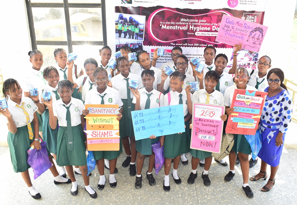 3. Excited school girls displaying their packs of sanitary pads after the conference on menstrual hygiene by NGO CEE-HOPE in Lagos recently