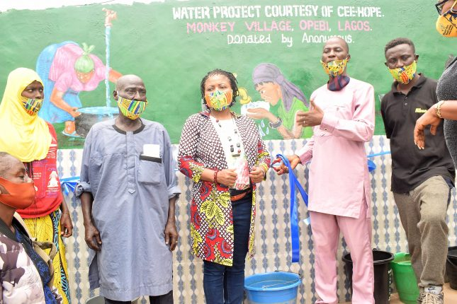 Lekan-Otufodunrin-standing-4th-left-Board-Member-of-CEE-HOPE-commissioning-the-water-project-at-Monkey-Village-recently-while-CEE-HOPEs-founder-Betty-Abah-and-community-members-scaled.jpg